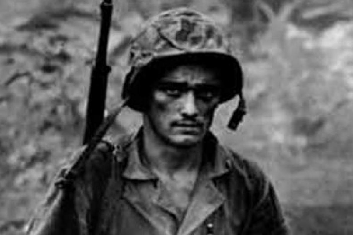 Black and white photograph of a US soldier during WWII