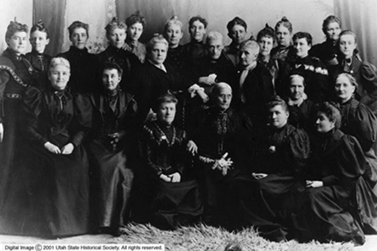 Utah suffrage leaders, including Martha Cannon, Emily S. Richards, Sarah Kimball, Emmeline B. Wells, Zina D. Young, along with Colorado suffrage leaders Mary C. C. Bradford and Lyle Meredith Stansbury, accompany Susan B. Anthony and Rev. Anne Howard Shaw.