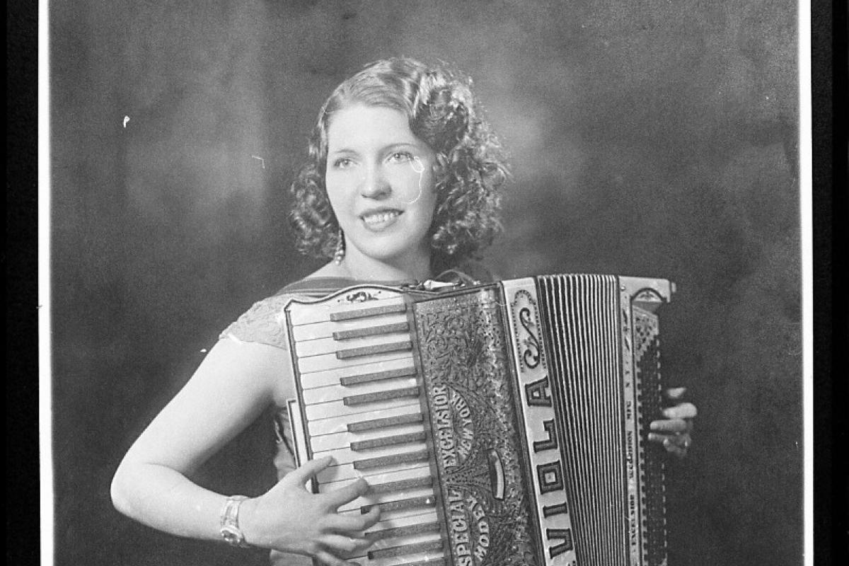 Accordionist Viola Turpeinen sitting down