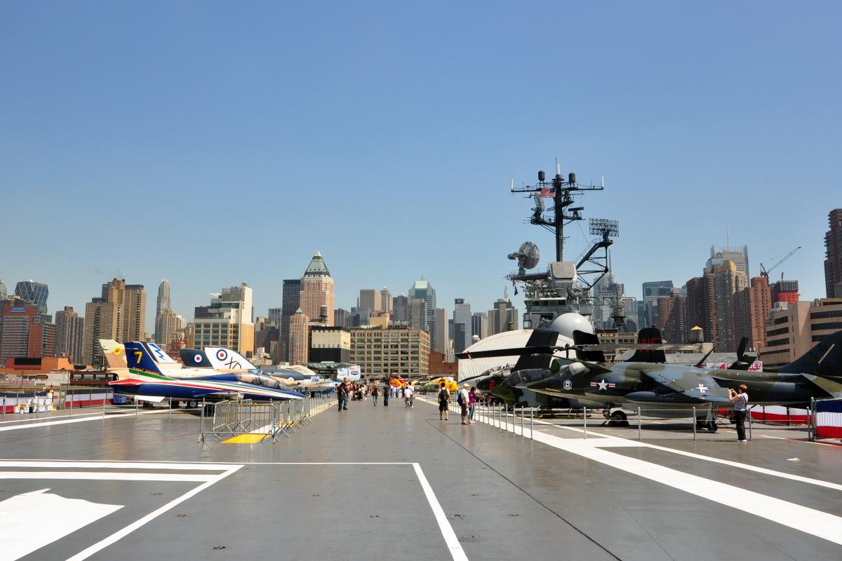 Photograph of various fighter jets on flight deck of USS Intrepid