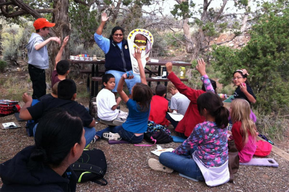 Students learning about Ute cultural artifacts.