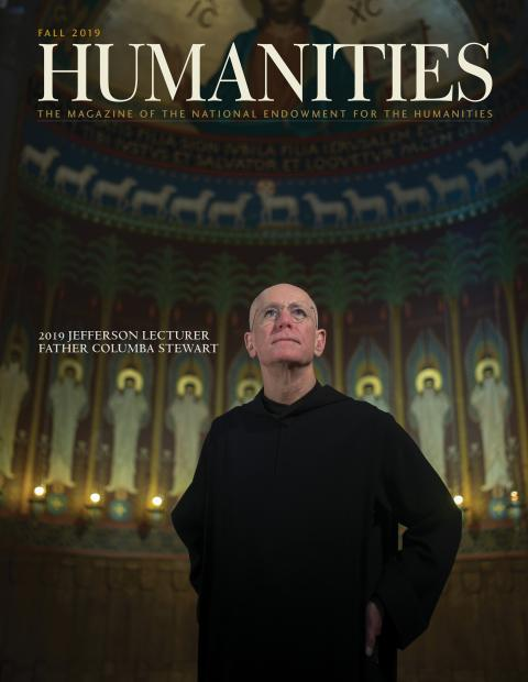 2019 Jefferson Lecturer in the Humanities Father Columba Stewart standing in the Great Hall at Saint John's University in Collegeville, Minnesota.