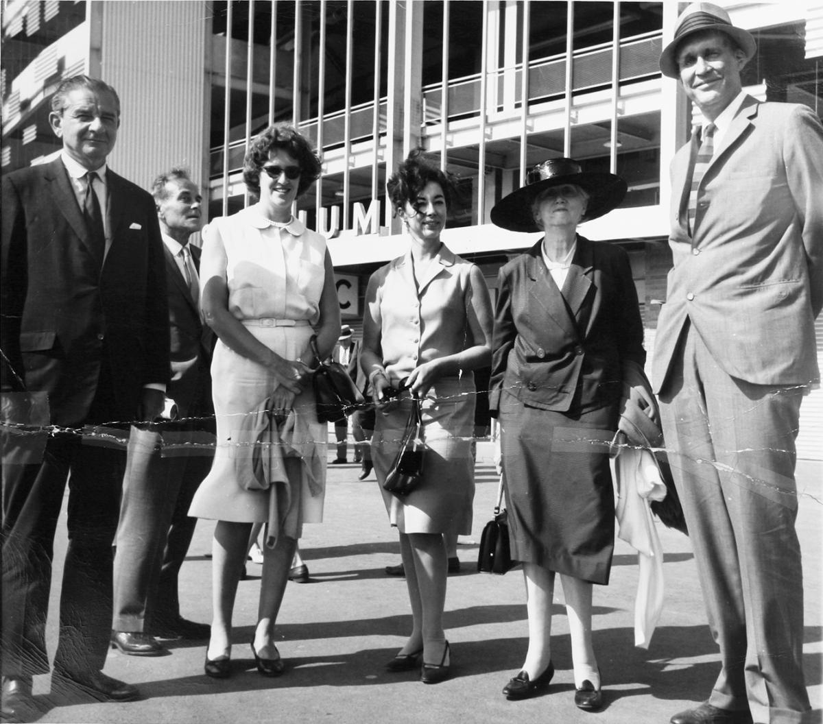unidentified man (standing back) Monroe Wheeler, Ann Laughlin, Gertrude Vanderbilt Whitney, Marianne Moore, and James Laughlin standing outside Shea Stadium in Queens for a New York Mets baseball game.