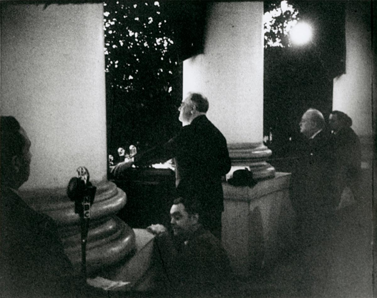 Churchill looks on as Roosevelt delivers his remarks at the Christmas tree lighting on December 24, 1941