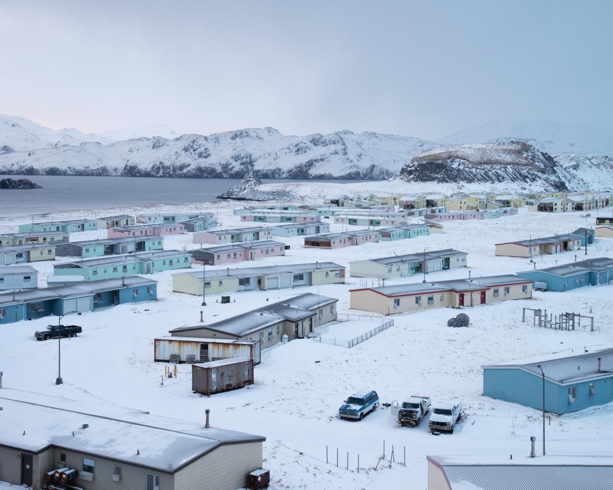 Wide shot photography of a series of houses and a snowy landscape