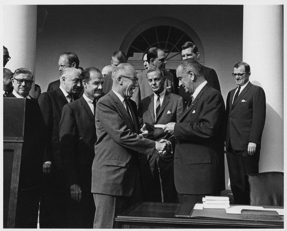 West Virginia Congressman Ken Hechler shakes hands with President Lyndon Johnson