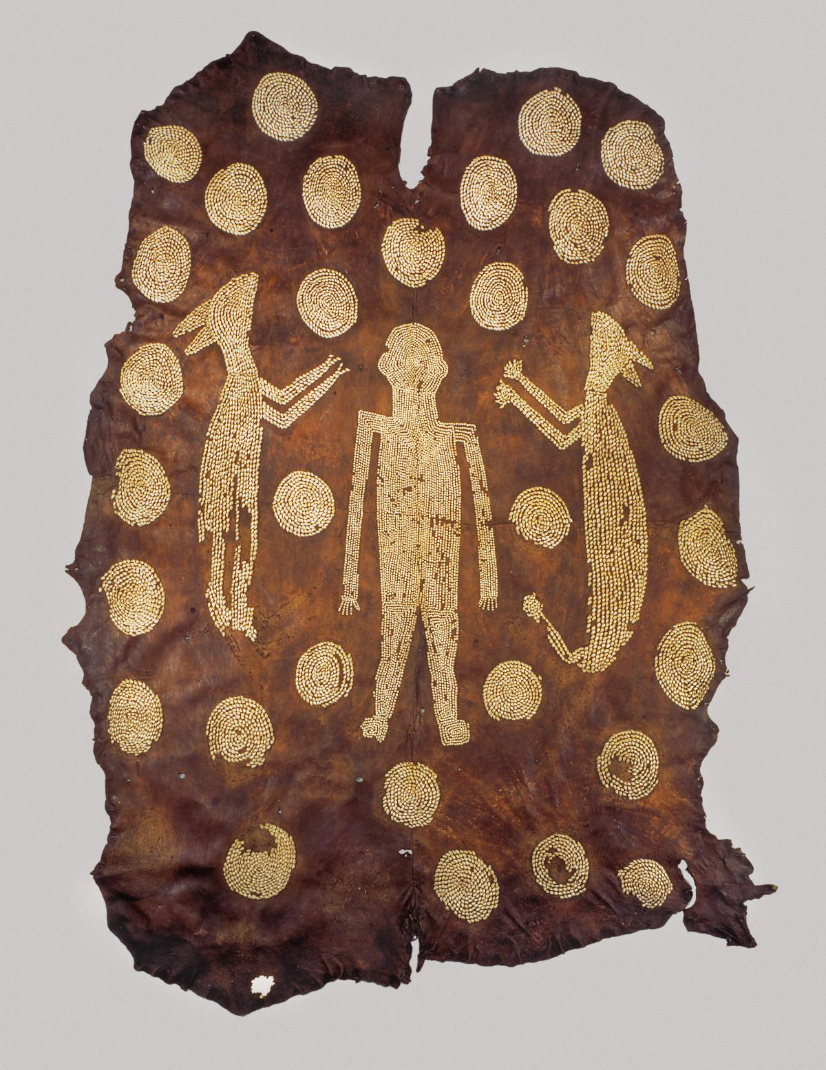 deerskin with a man carved into it