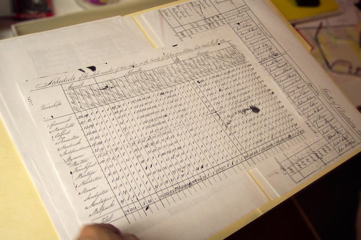 A piece of paper printed with a table of data, with handwritten notes