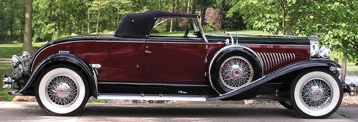 Maroon convertible, with black and white trim