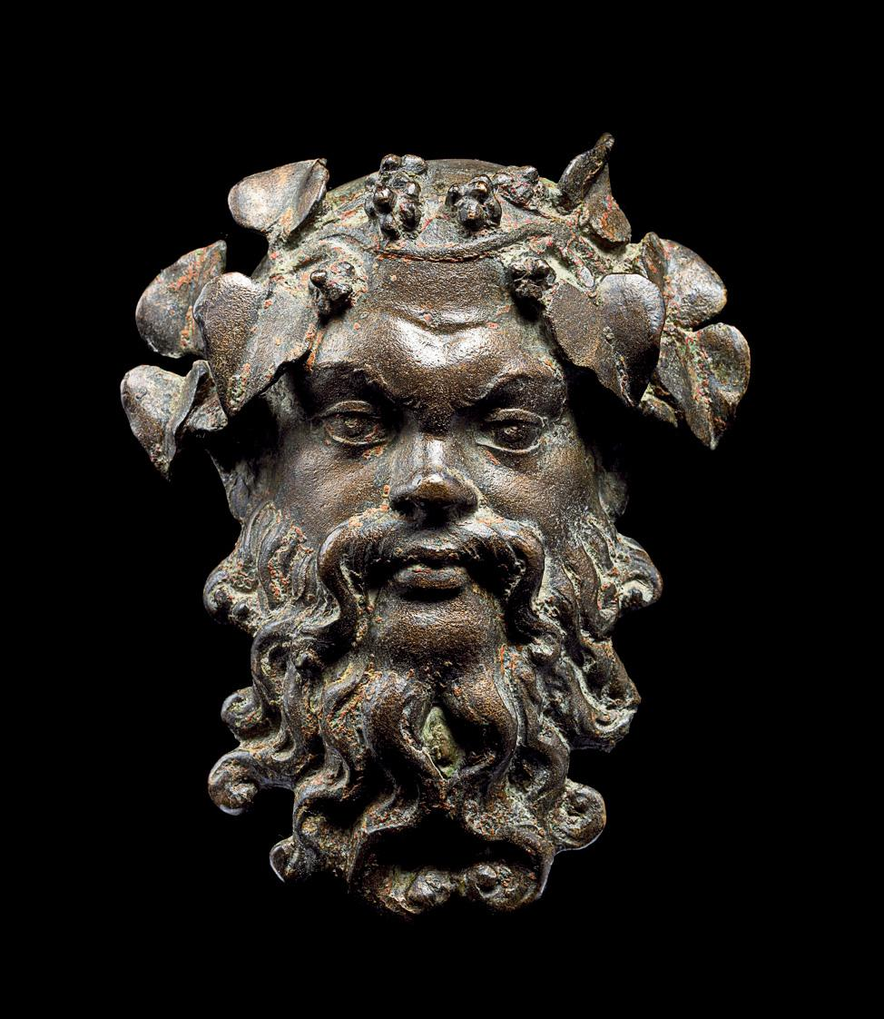 Photograph of a bronze mask of a man with a beard