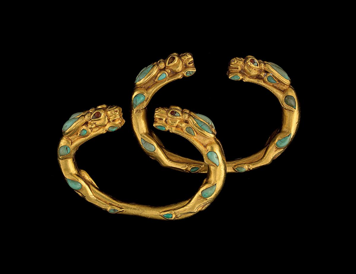 two golden bracelets with turquoise stones inlaid