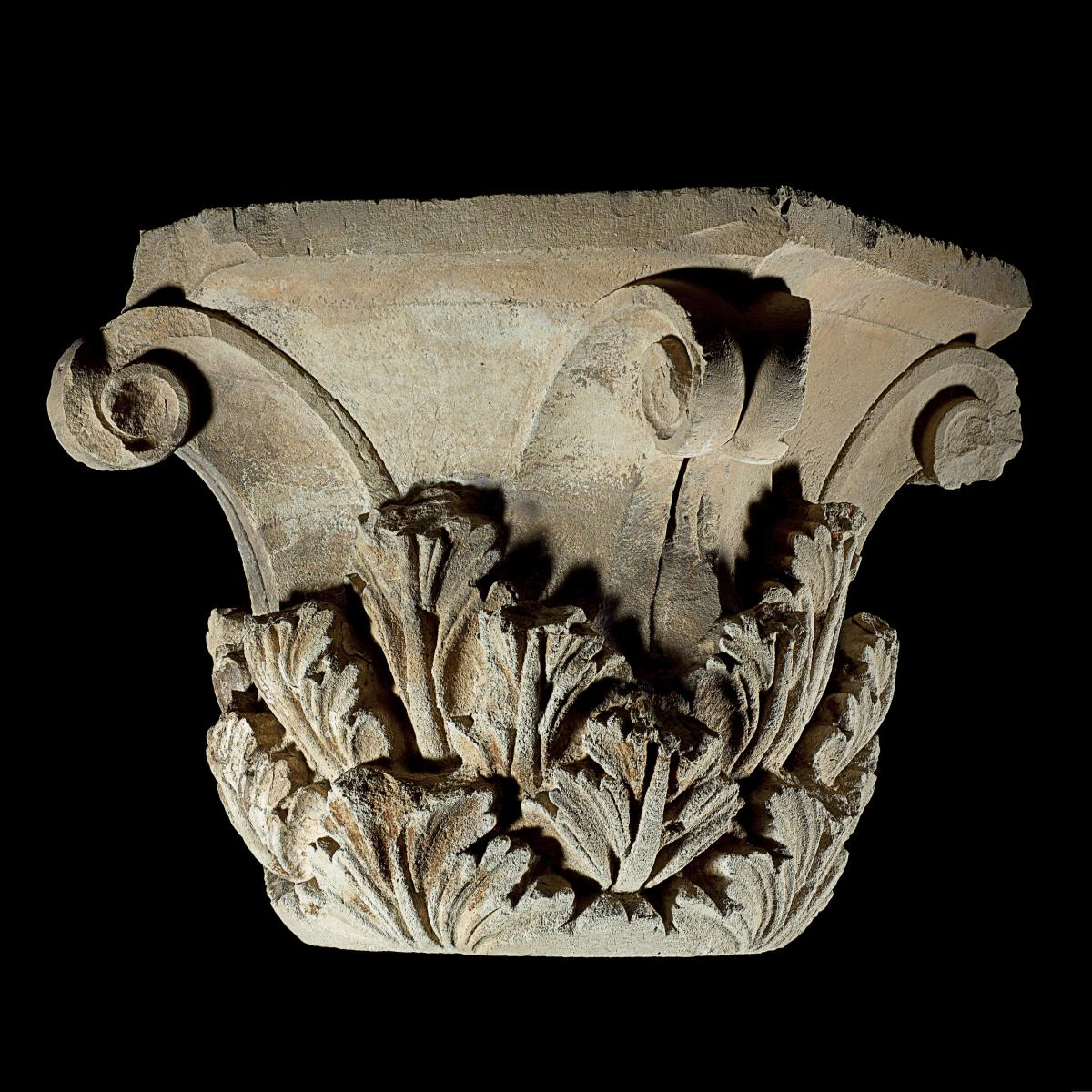 Photograph of a corinthian capital, leaves carved from stone