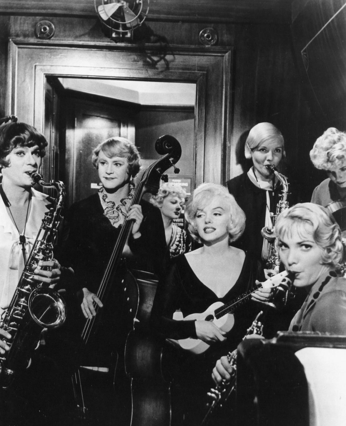 black and white film still of three women playing musical instruments