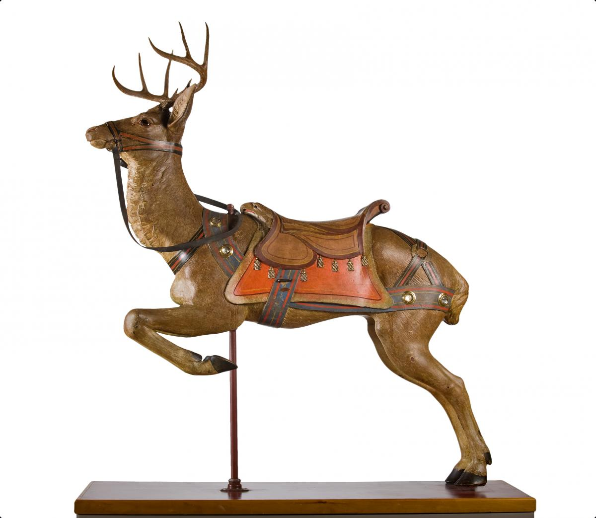 Photograph of a wooden carved deer