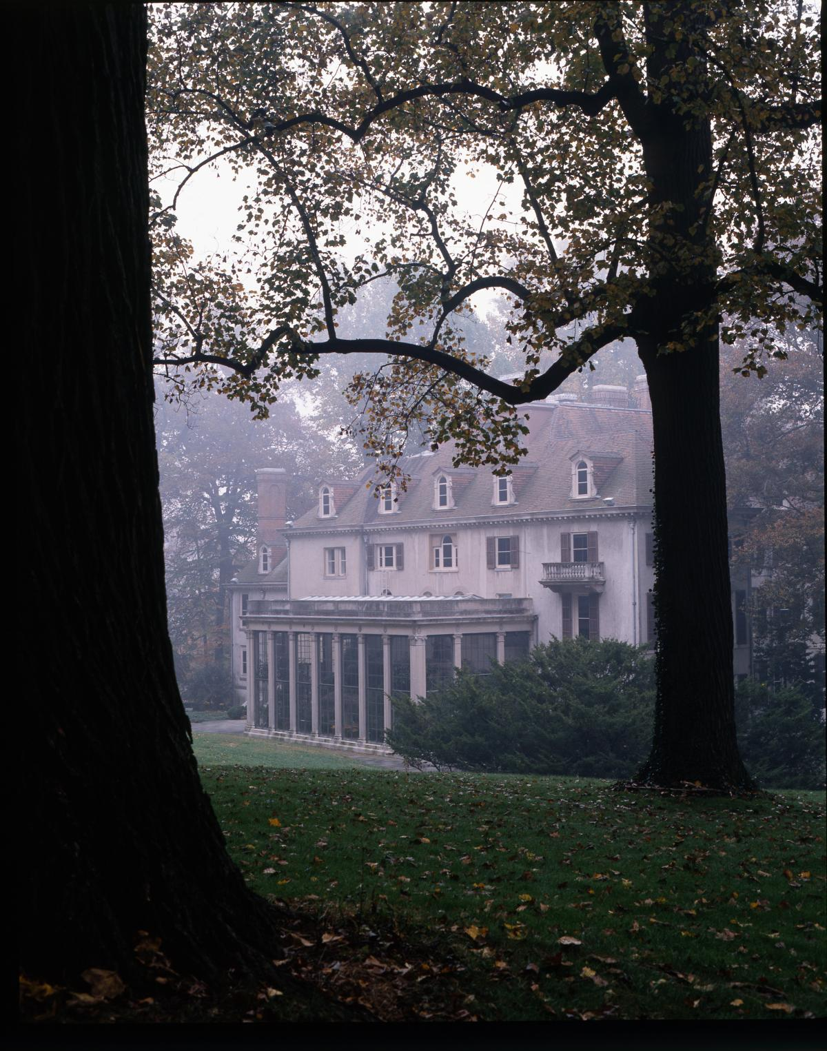 Photograph of a large house, shrouded in slight mist