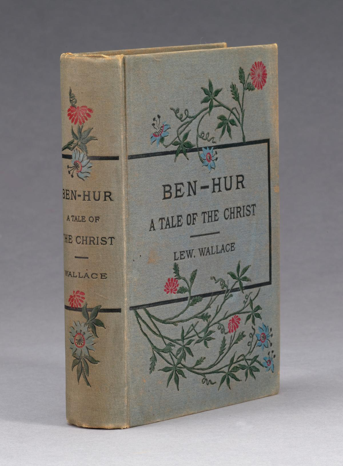 Cream colored cover and spine, decorated with twining vines and flowers, which border the title and author text