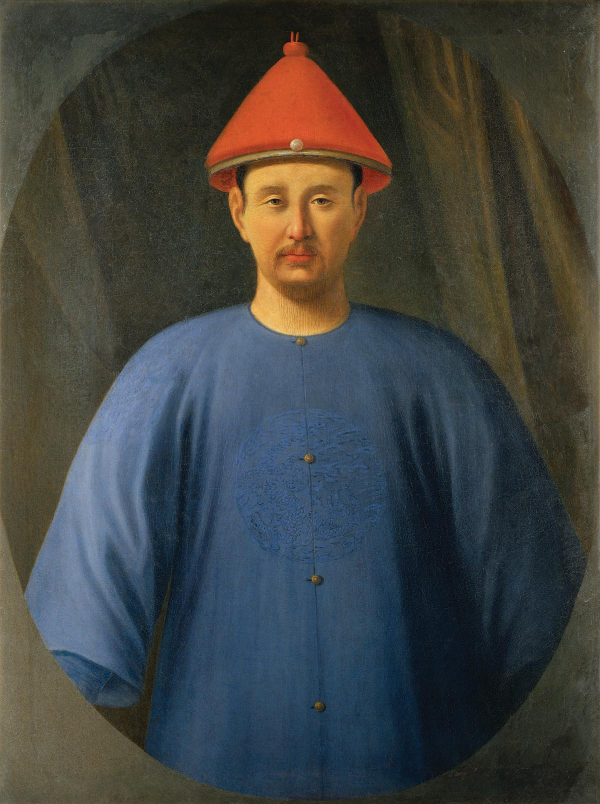 Emperor, clean shaven, wearing a conical red hat and plain blue smock