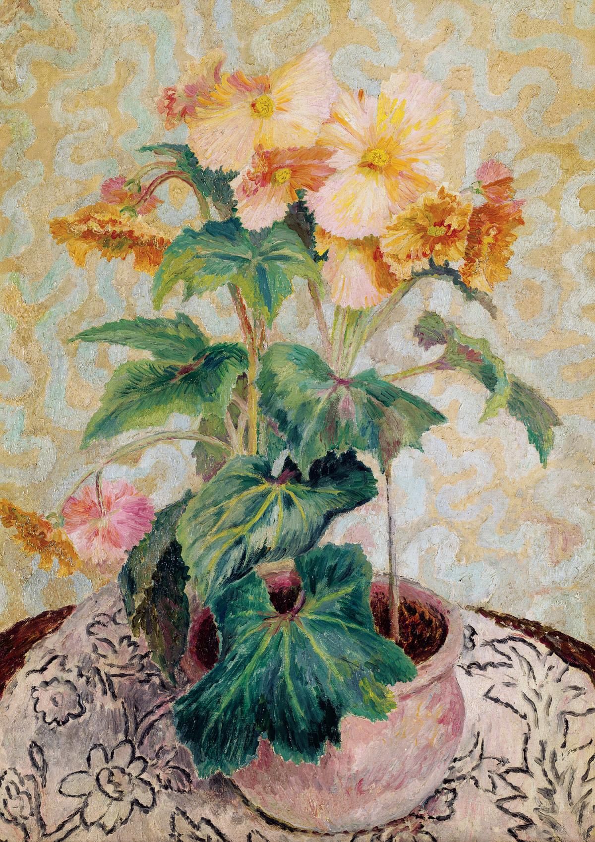 A bouquet of yellow begonias in a round clay pot, sitting on a table covered with a black and white floral tablecloth