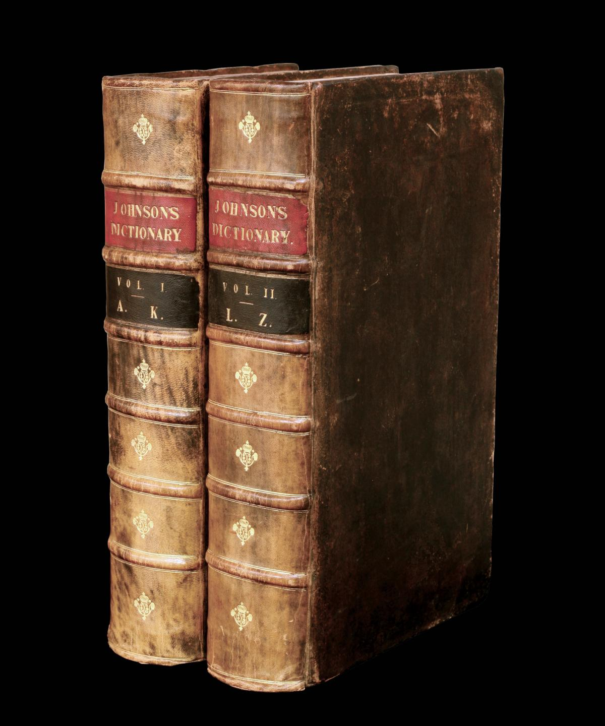 two volumes of the 1755 dictionary, bound in brown leather with red, black and gold bands on the spines