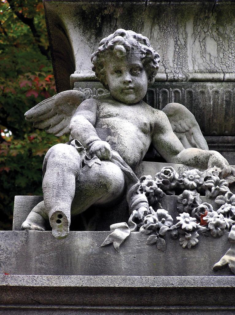 Photograph of a cherub carved out of stone