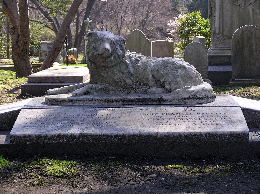 Photograph of a headstone, a marble dog