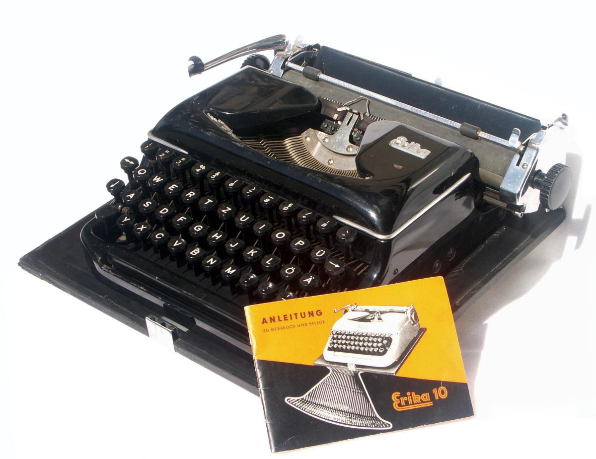 Black typewriter with silver furnishings