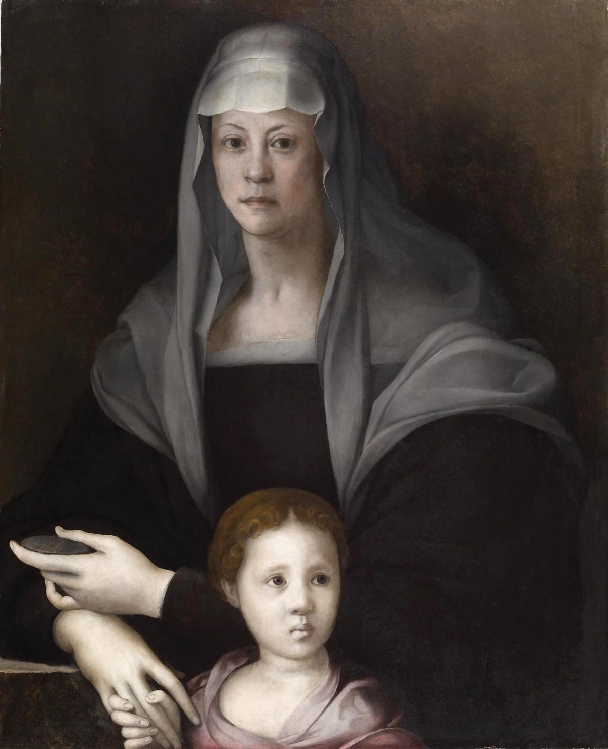 Maria, wearing a grey headdress and dark dress, with Giulia standing in front of her, in a pink dress