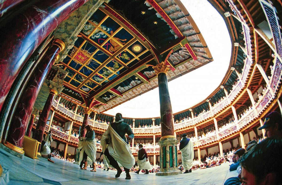 Ground view looking up, on-stage at shakespeare's globe, showing the painted ceilings and columns