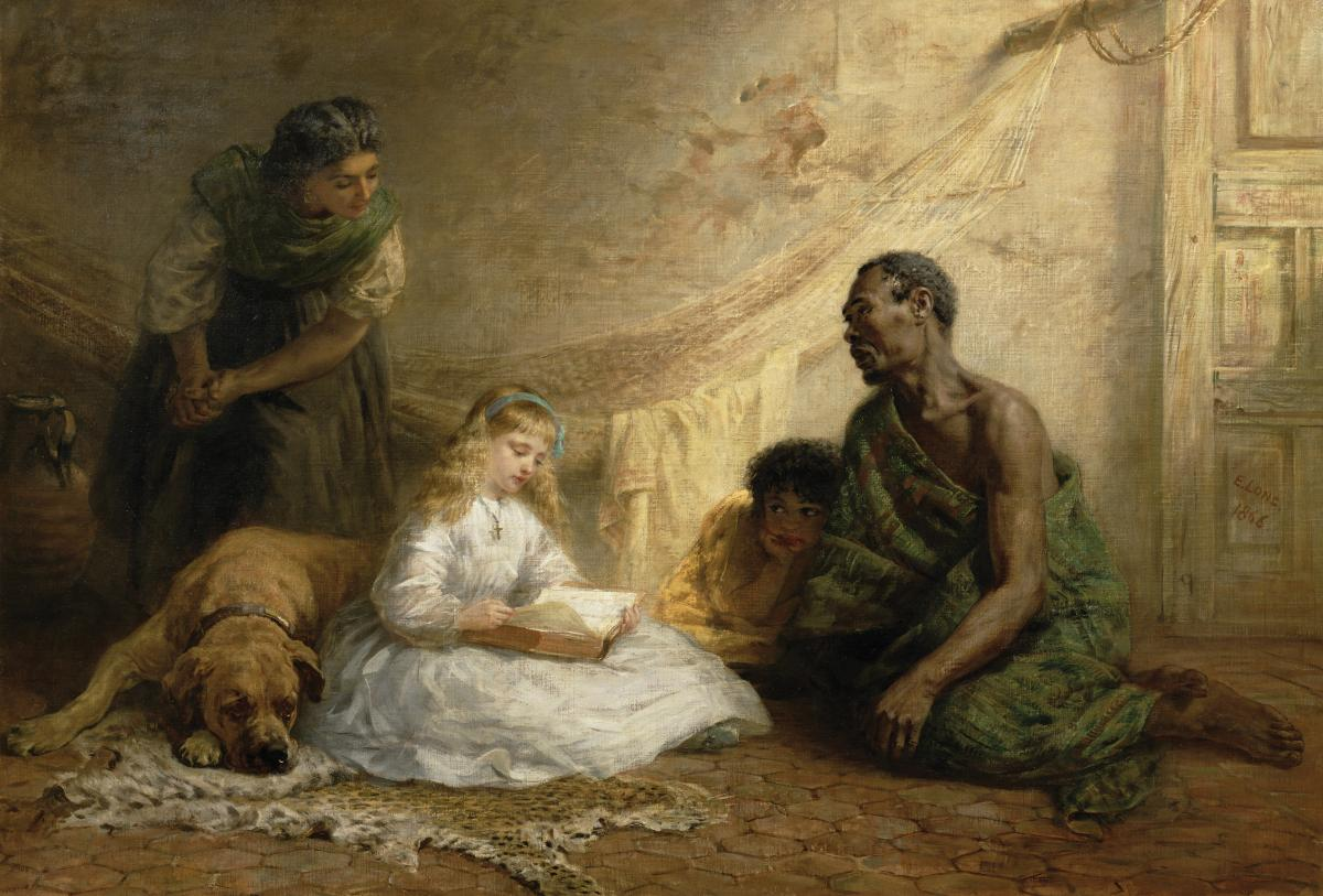 Eva, in a white dress, reads to Uncle Tom and another child, while they sit on the ground