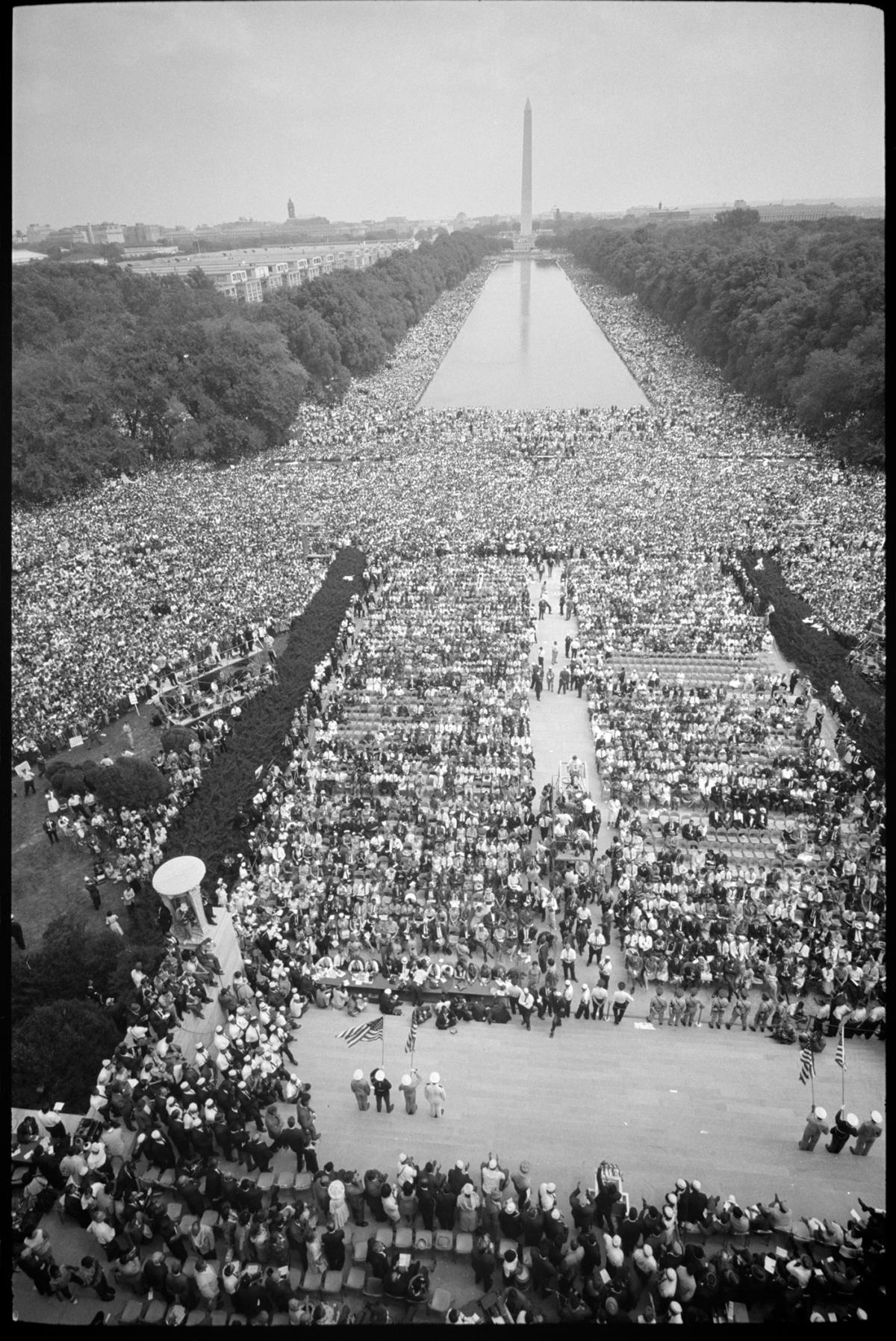 black and white photograph of view down the national mall, large crowd of people