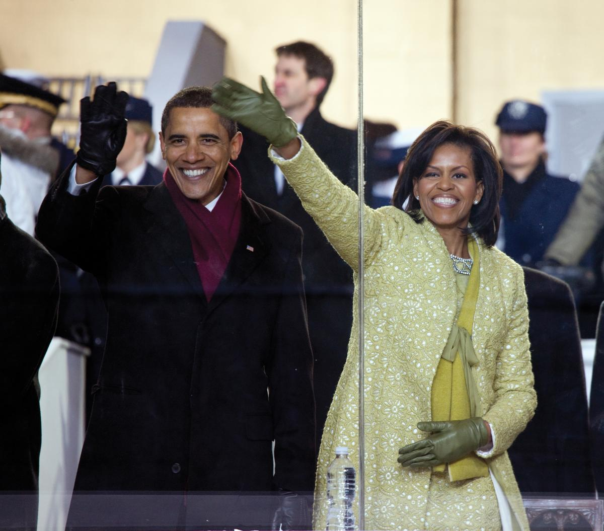 colored photo of Barack Obama and Michelle Obama waving