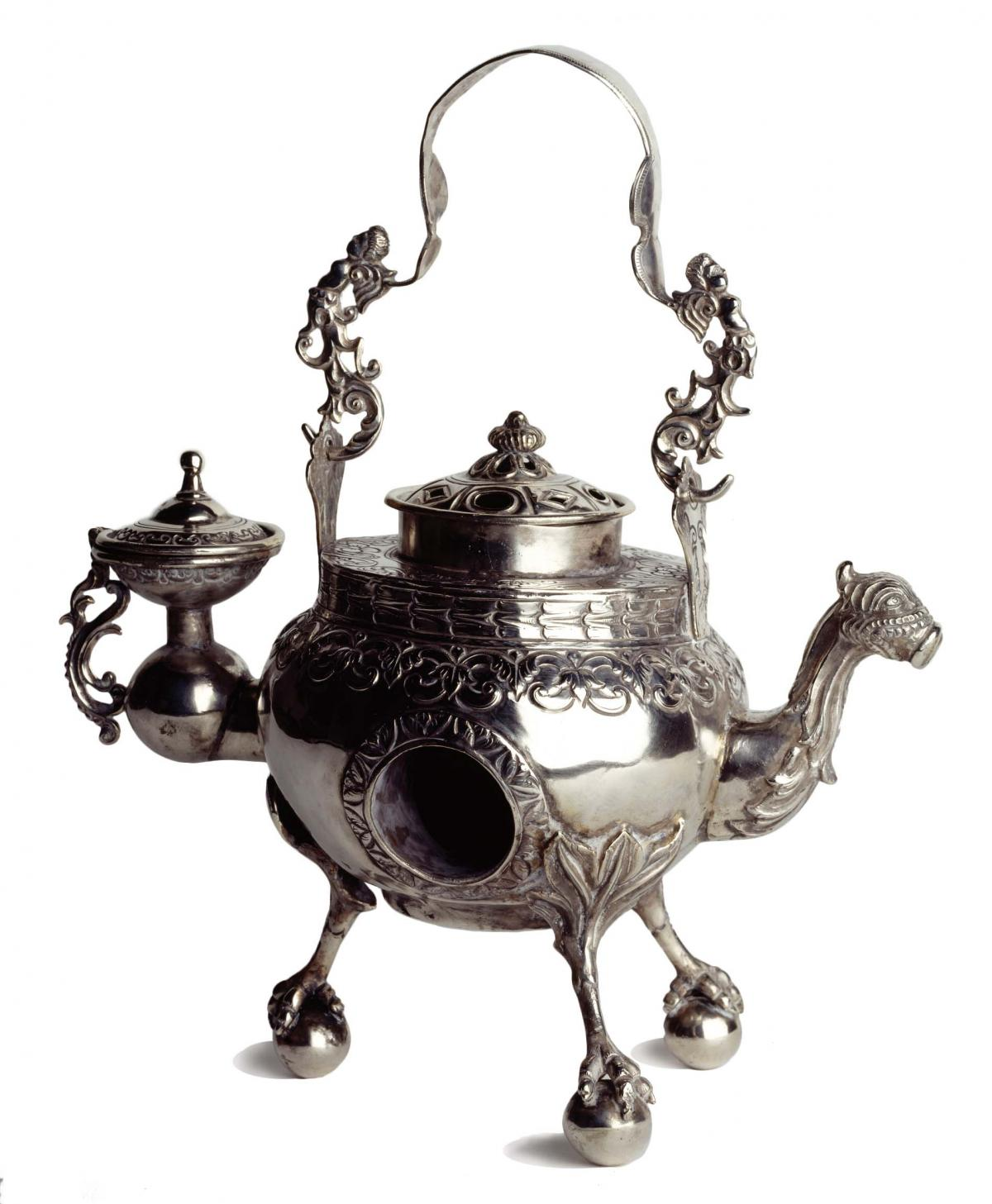 Silver water heater, with a camel head for a spout and hoofed legs for stands, with elaborate filigree work