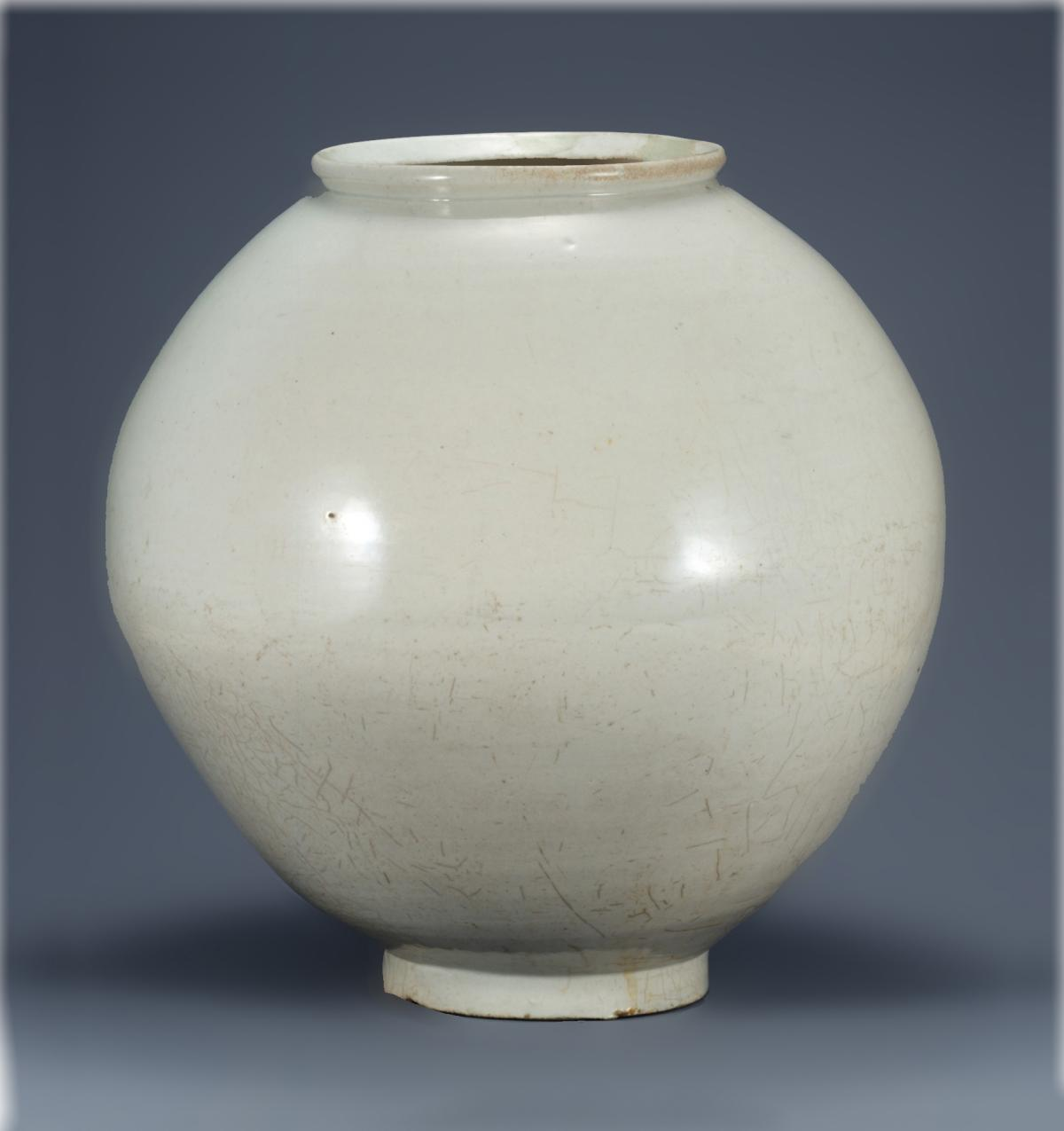 White porcelain jar, wide in the middle, with a narrower mouth and base