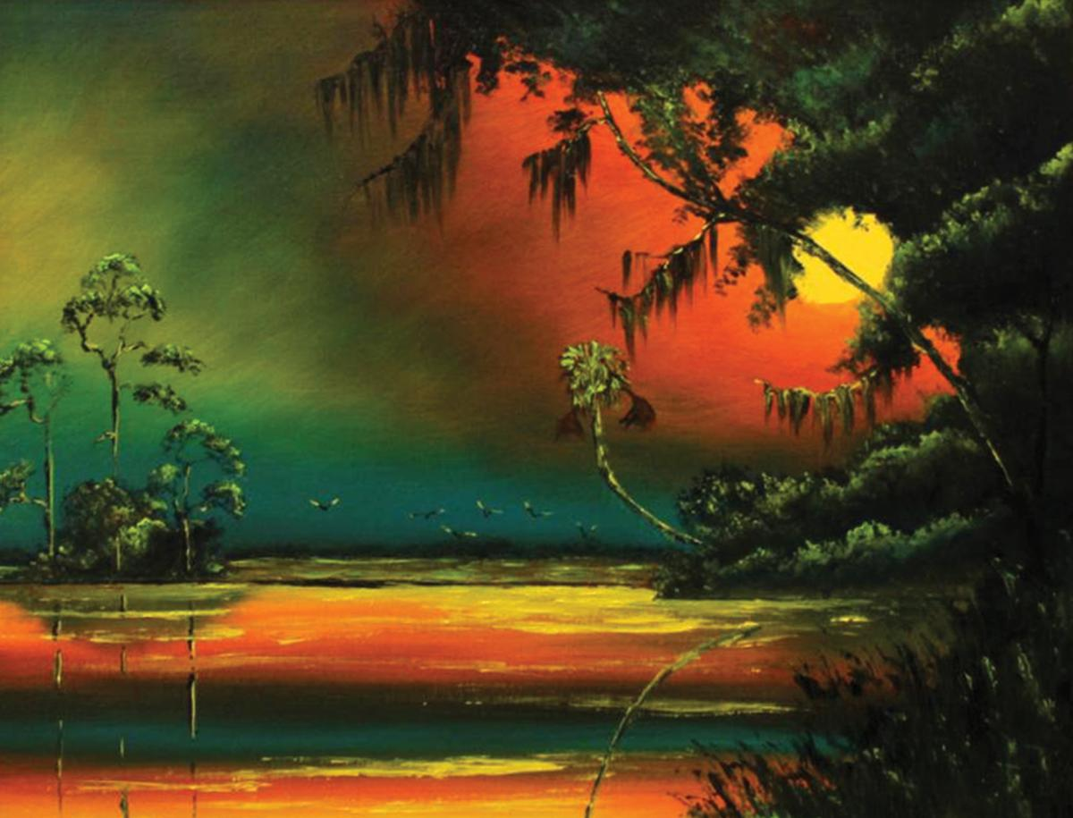 Vivid sunset in orange, green and yellow, over the ocean