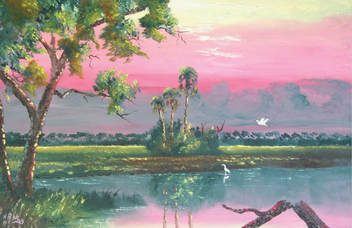 Pink skies over a marshy lake, with green trees
