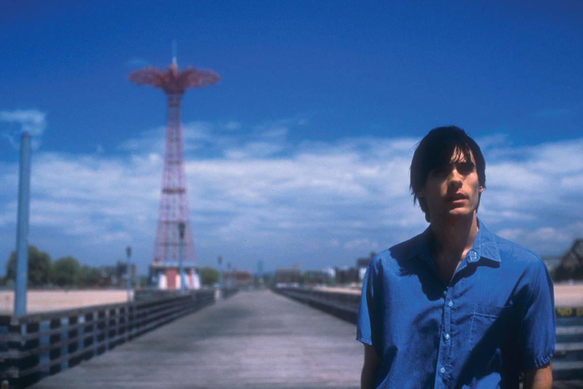 Movie still from Requiem for a Dream, showing the protagonist in a blue shirt at Coney Island