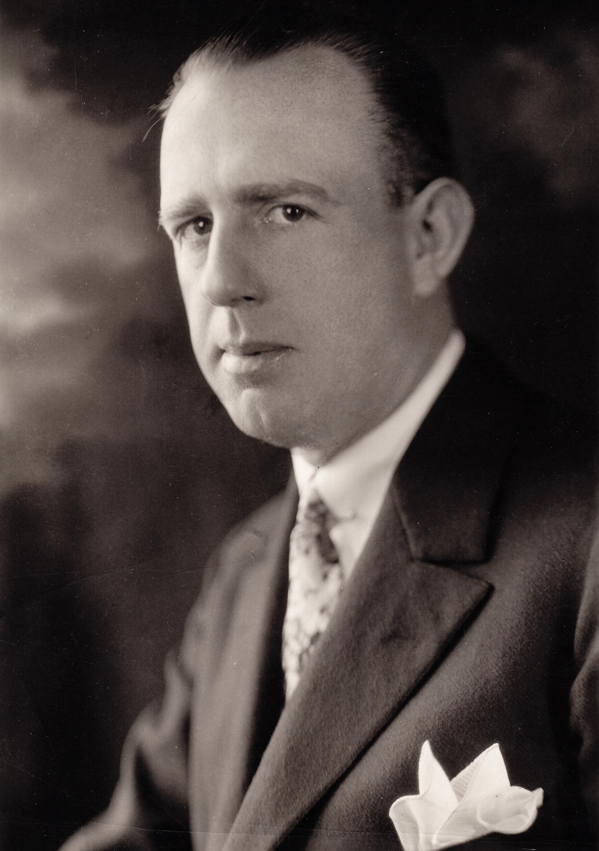 Shoulders-up photo of Powel Crosley, wearing a suit and pocket square