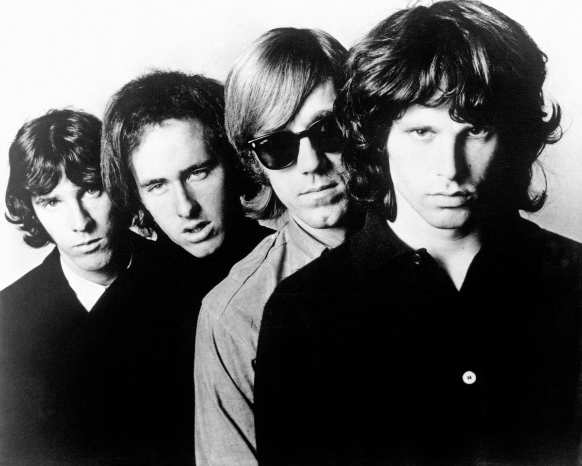 Black and white photo of various rock stars from the 1960s and 70s, including Jim Morrison.