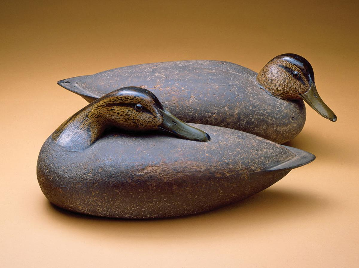 two wooden carved ducks