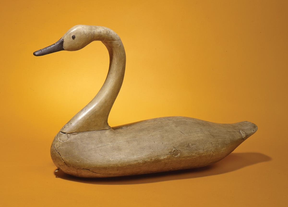wooden swan decoy, made from blonde wood
