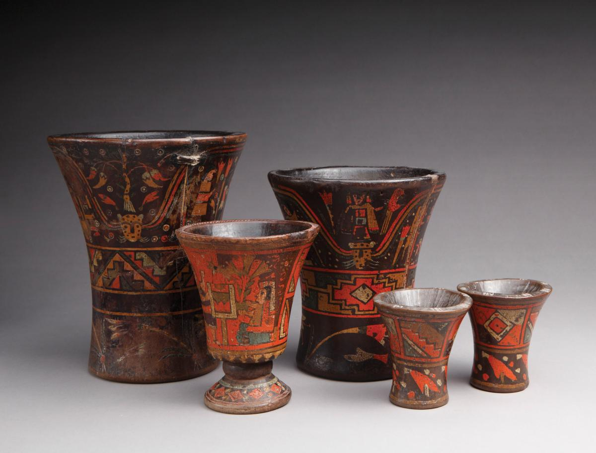 Set of five beakers, varying sizes, glazed in red, with wide mouths