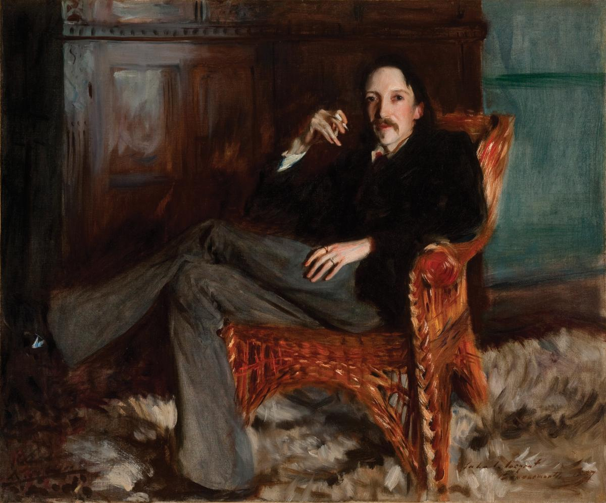 Stevenson sitting in a leather arm chair, legs crossed, holding a cigarette, wearing a dark suit