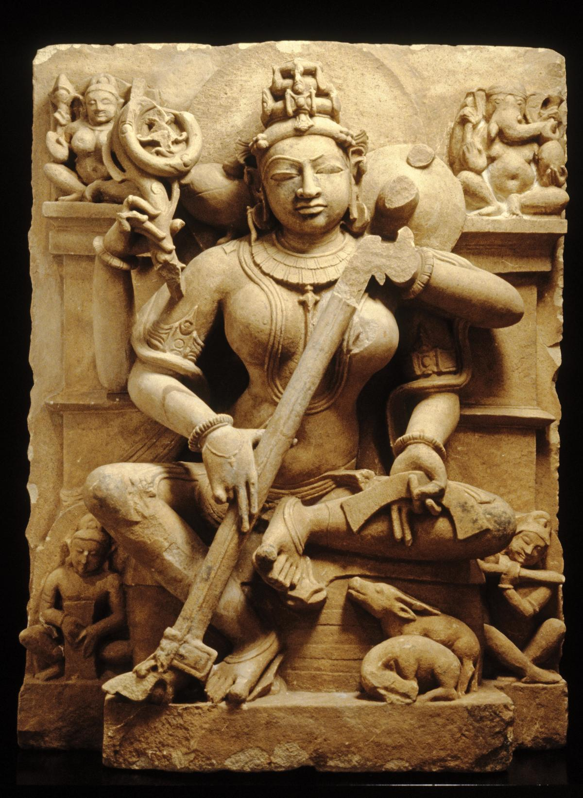 Sarasvati, goddess of speech, learning, and the arts, sculpted in sand-colored stone