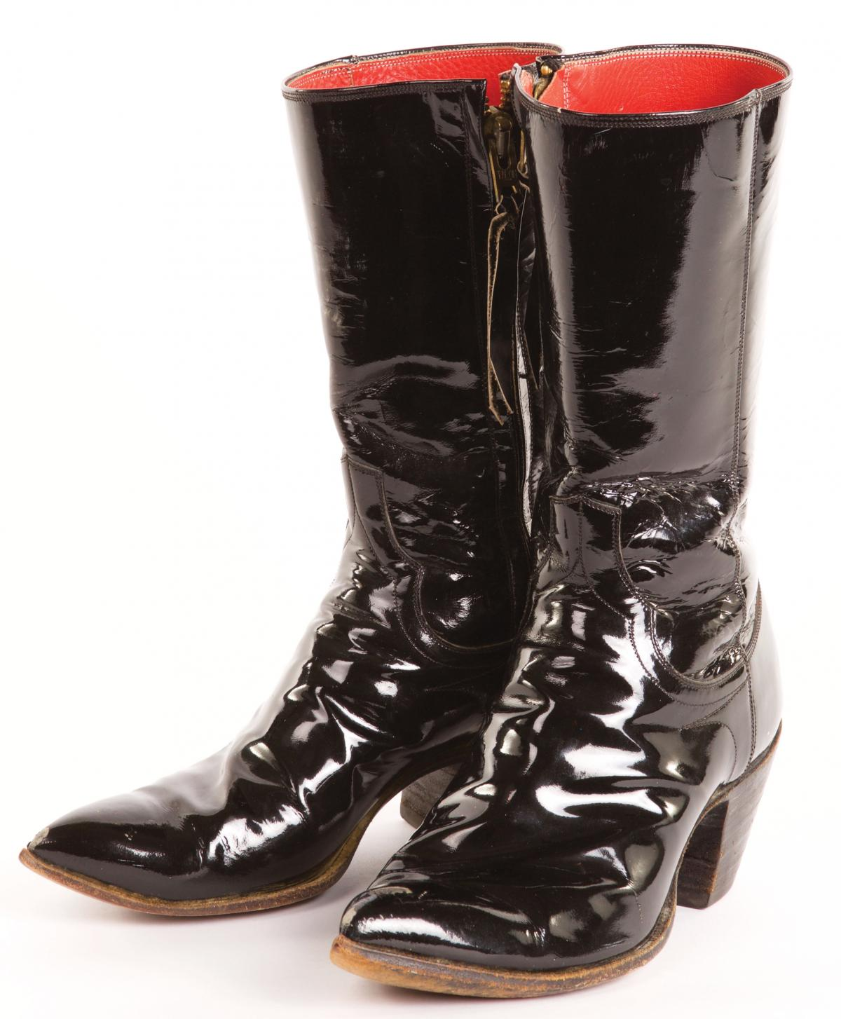 Phillips's trademark patent leather boots