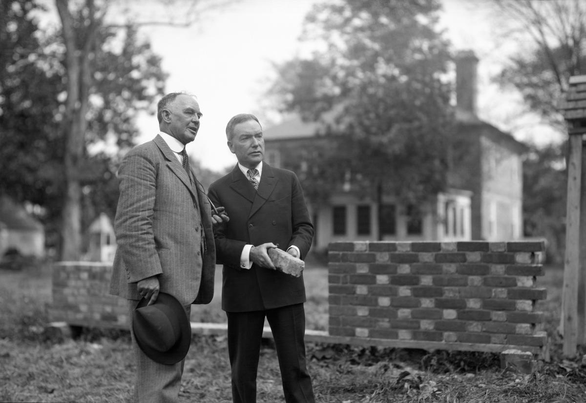 W.A.R. Goodwin and John D. Rockefeller, Jr, both in dark suits