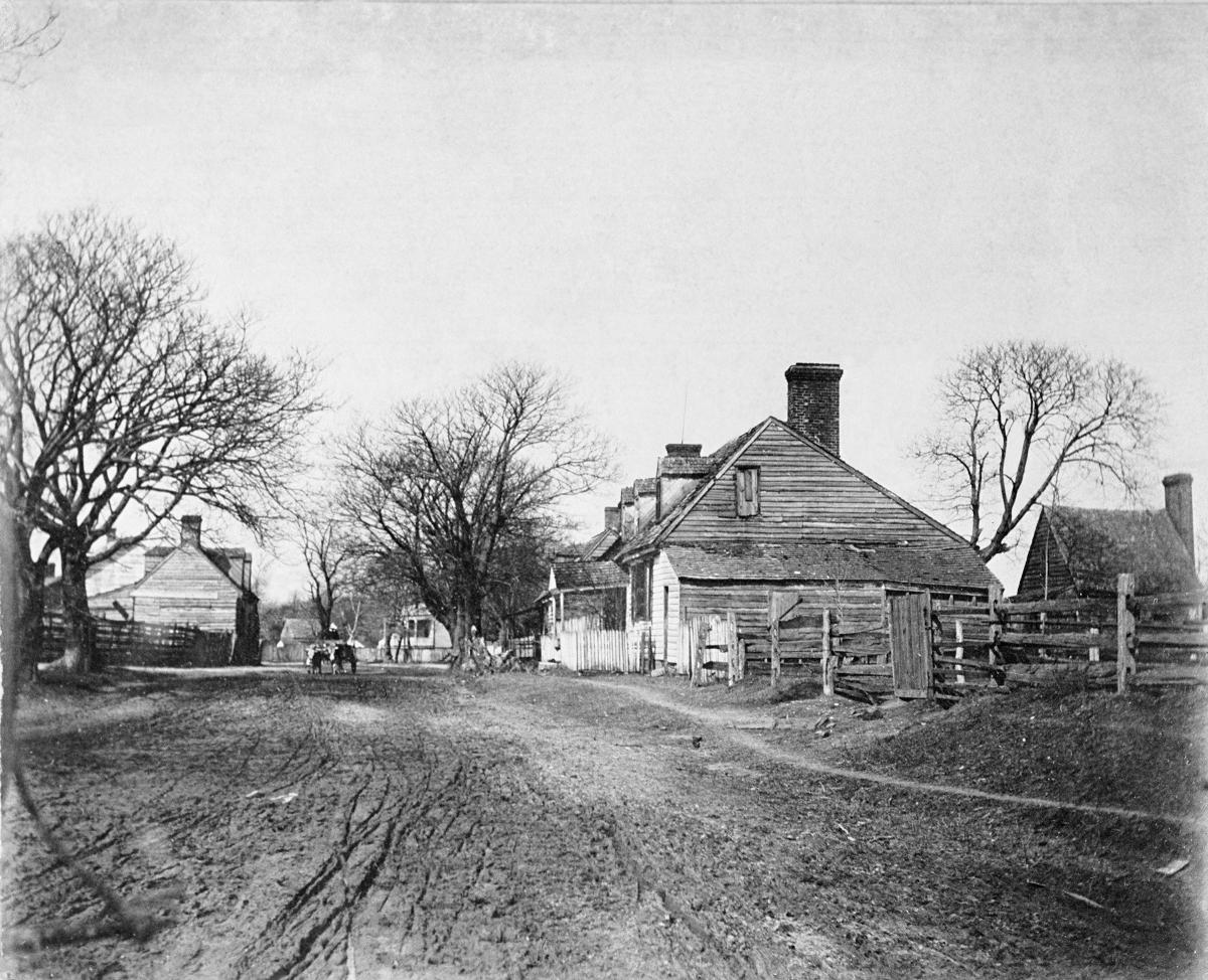 Francis Street, circa 1890: dirt road, wood slat houses, bare trees