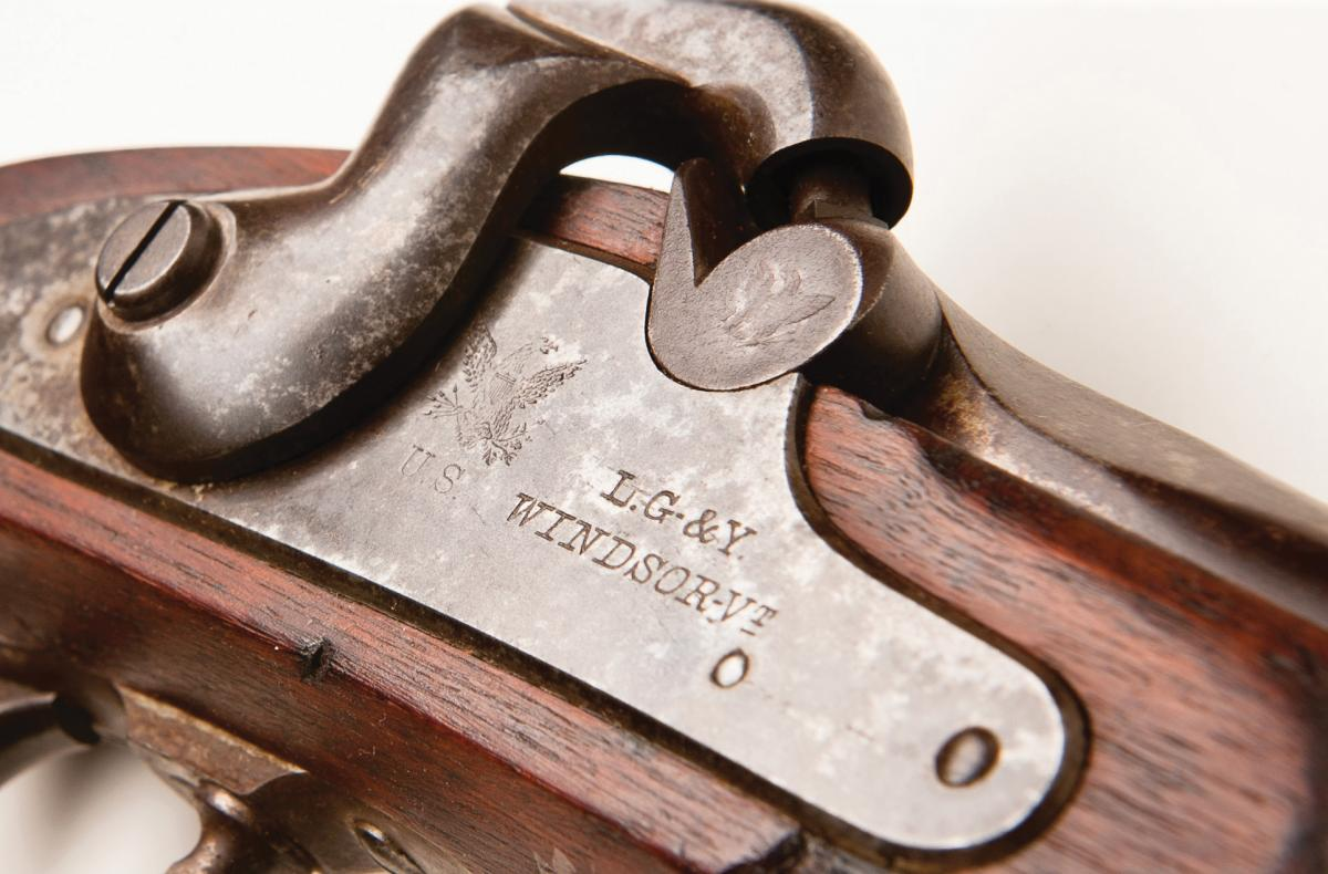 photograph of engraved plate on a gun