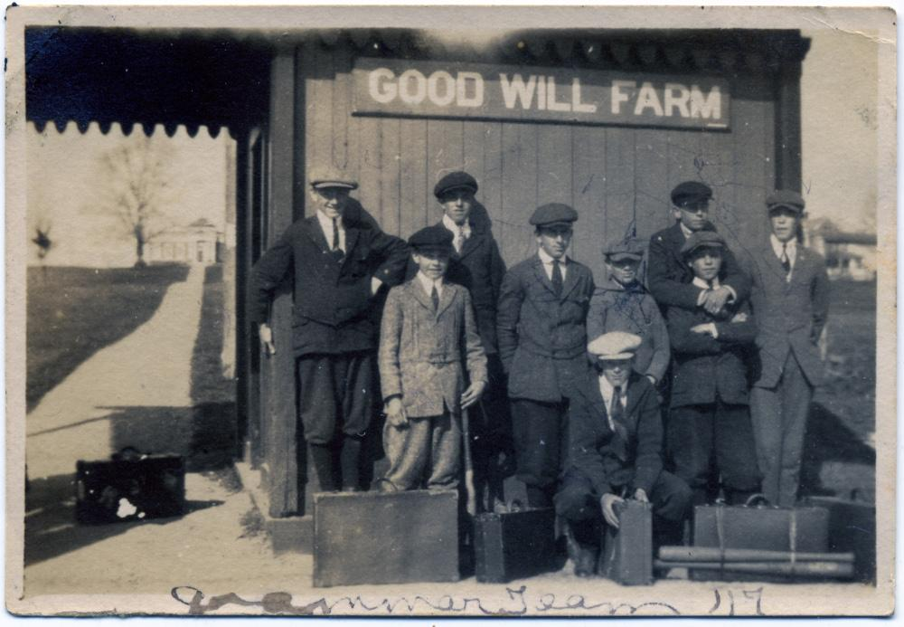 photo of boys at train station with luggage