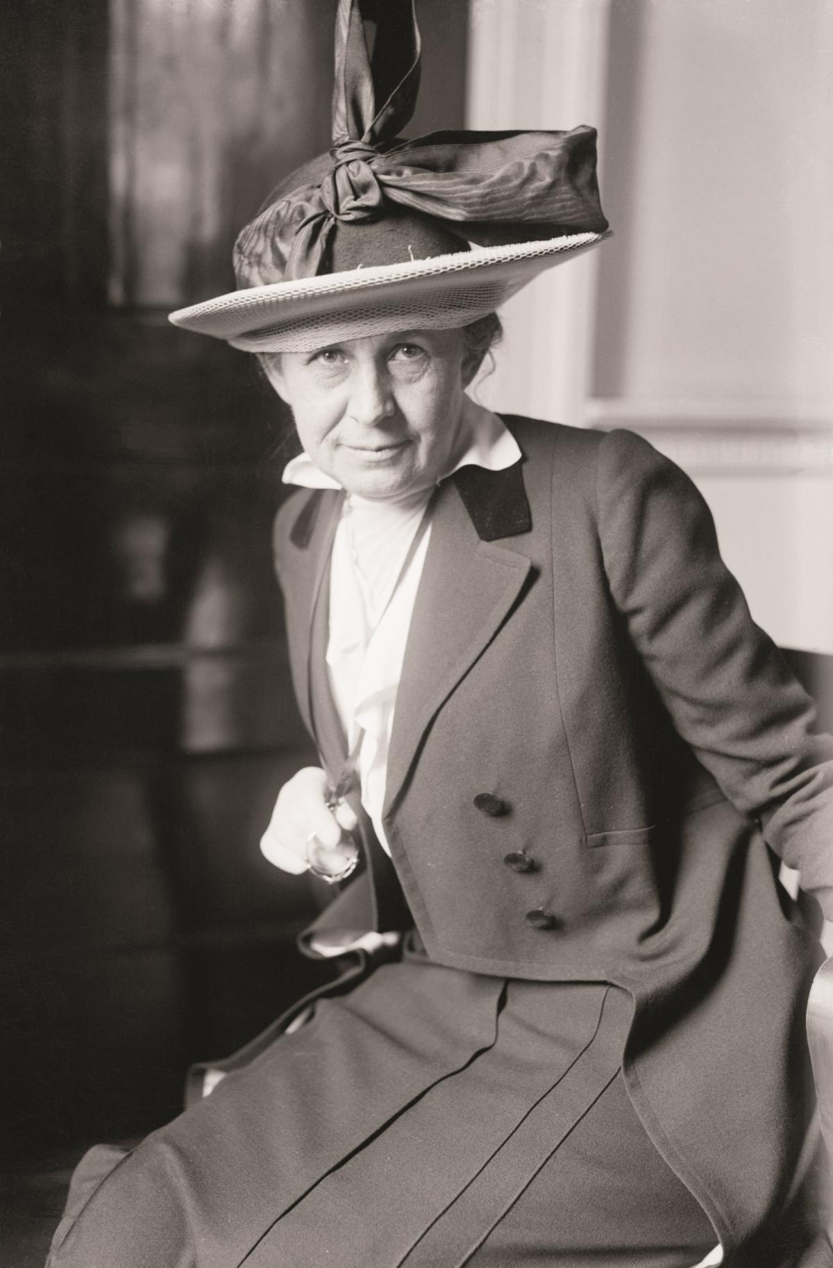 Black and white photograph of a woman in a hat