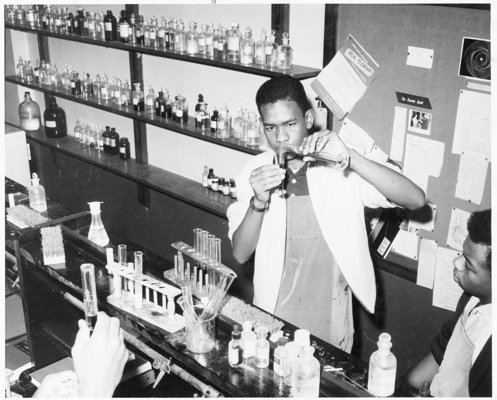 """Chemistry Student"" (circa 1960). James P. Brawley Collection."
